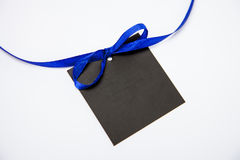 Empty black card with bow. On white background Royalty Free Stock Photography