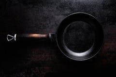 Empty black cast iron pan Royalty Free Stock Photography