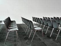 Empty chairs rows on white background stock photo