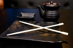 Empty black clear set for sushi,plate with Japanese chopstick,saucer on the black table. Empty black clear set for sushi,plate with Japanese bamboo chopstick royalty free stock image