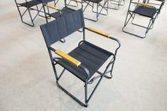 Empty black folding chairs Stock Photo
