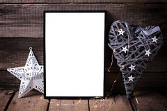 Empty  black  frame, decorative heart  and   star on  aged woode. N background. Place for text. Mock-up for design Royalty Free Stock Images