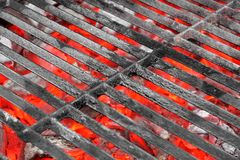 Empty Black Grill and Hot Coals. Empty Black Cast Iron Grill and Hot Red Glowing Coals. Background with space for text or image Royalty Free Stock Photos