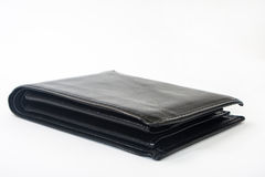 Empty black leather wallet on a white background Royalty Free Stock Photo