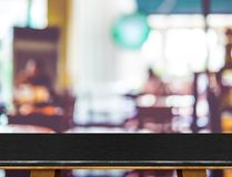 Empty black marble table and blurred cafe bokeh light background Stock Photo