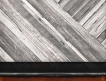 Empty black marble table and blurred diagonal plank wooden wall Stock Photos