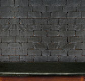 Empty black marble table and white black brick wall in backgroun Stock Photo
