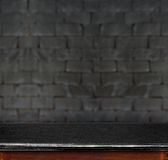 Empty black marble table and white black brick wall in background. product display template. royalty free stock images