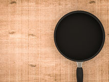Empty black pan on wooden table Royalty Free Stock Image