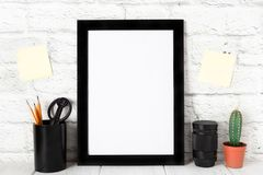 Empty black photo frame on wooden shelf or table. Mockup with copy space. stock image