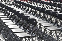 Empty black plastic chairs Stock Photo