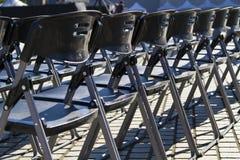 Empty black plastic chairs Stock Photography