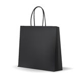 Empty Black Shopping Bag  for advertising and branding. Royalty Free Stock Photos
