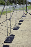 Empty black swings vertical Stock Photos