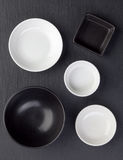 Empty black and white bowls Stock Photo