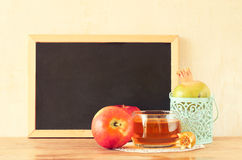 Empty blackboard, apple, honey and pomegranate. rosh hshanah concept. Royalty Free Stock Image