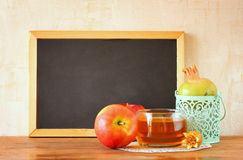 Empty blackboard, apple, honey and pomegranate. rosh hshanah concept Stock Image