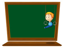 An empty blackboard with a boy hanging Royalty Free Stock Image