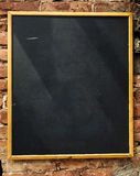 Empty blackboard on brick wall Stock Photos