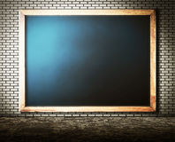 Empty blackboard on brick Wall with grunge cement floor for abst Royalty Free Stock Photos