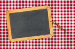 Empty blackboard with chalk on a checkered table cloth Stock Photo