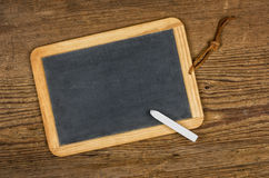 Empty blackboard with chalk on a wooden background Royalty Free Stock Photo