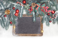 Empty blackboard with Christmas decorations on snow, space Stock Images