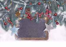 Empty blackboard with Christmas decorations on snow, space Stock Image