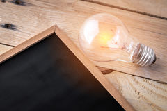 Empty blackboard with light bulb Royalty Free Stock Images