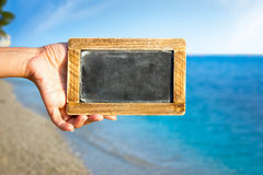 Empty blackboard over beautiful sea shore Stock Photos