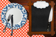 Empty Blackboard Plate and Cutlery Royalty Free Stock Images