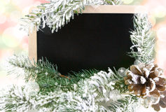 Empty blackboard with snowy Christmas tree Stock Photo