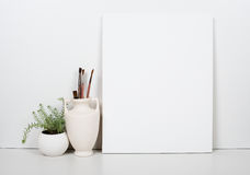 Empty blank canvas on a white background, home interior decor Royalty Free Stock Image