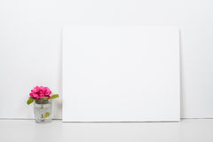 Empty blank canvas on a white background, home interior decor Stock Images