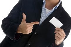 EMPTY BLANK CARD - pointing towards business card. Young american male pointing towards business card against white background Stock Photography