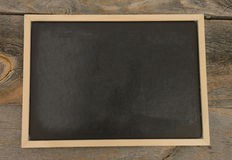 Empty or blank chalkboard. Blank chalkboard on a rustic background Royalty Free Stock Photos
