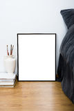 Empty blank classic black frame on a floor, minimal home bedroom. Interior decor, painting art poster mock-up Royalty Free Stock Photo