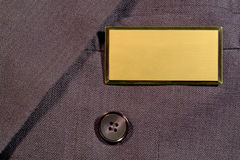 Empty Blank Name Tag for Text on Business Suit stock images