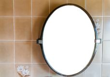 Empty blank plastic mirror hanging on the wall in the bathroom with retro tiling background. A Empty blank plastic mirror hanging on the wall in the bathroom stock images