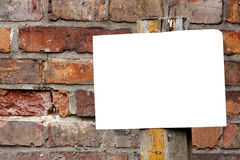 Empty blank plate on brick wall stock image