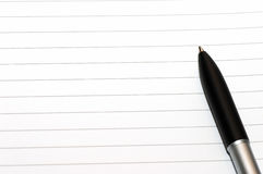 Empty blank ring, notepad, one pen. Empty blank ring, notepad, one slanted black pen on bottom right white page Stock Photo