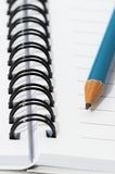 Empty blank ring, spiral notepad, blue pencil. Close up royalty free stock photography