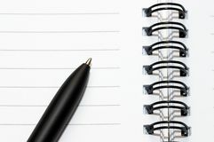 Empty blank ring, spiral notepad, one pen Royalty Free Stock Image