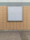 Empty blank square white advertising billboard on orange tiled wall Royalty Free Stock Photos