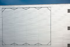Blank billboard steel frame on facade of industial style building Royalty Free Stock Photos
