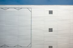 Blank billboard steel frame on facade of industial style building Stock Photography