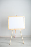 Empty blank whiteboard in the light room. Empty blank whiteboard in the room Royalty Free Stock Images
