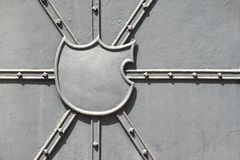 Empty blazon on a metal door Royalty Free Stock Photo