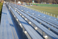 Empty Bleachers. Oblique view of empty metal bleachers at a soccer complex Stock Photos