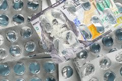 Empty blister pack of pills with new 100 dollars banknote picture. Medical concept of expensive treatment in USA. Empty blister pack of pills with new 100 stock photo